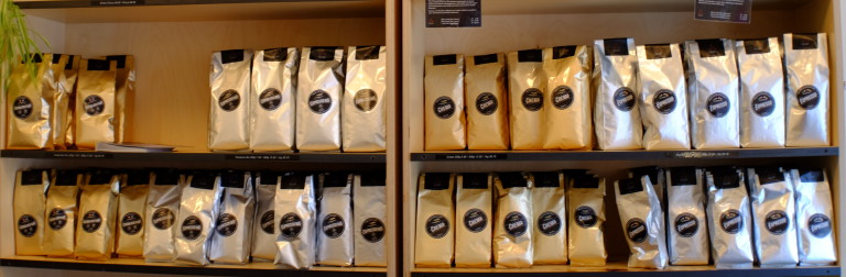 shelves filled with bags of coffee