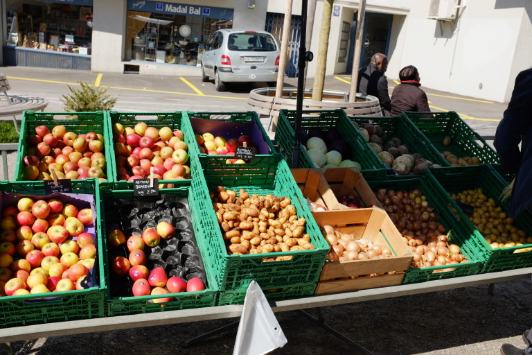 crates of apples at market