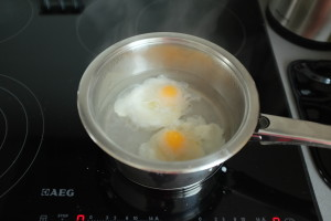 pan of water with 2 poached eggs in it
