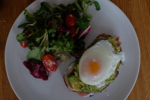 parma ham, avocado and egg on toast with salad