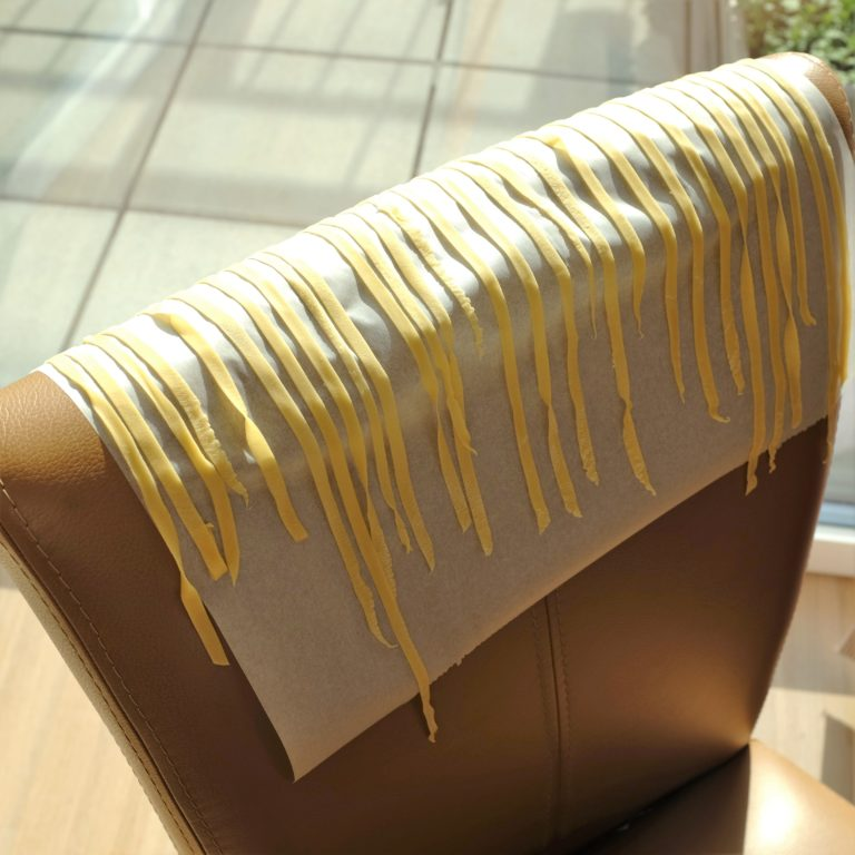 pasta on backs of chairs